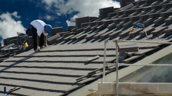 This is a picture of an asphalt roofing service.